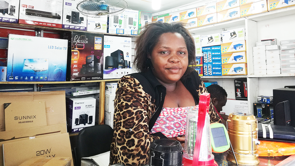 Agnes at her solar shop in downton Dar Es Salaam